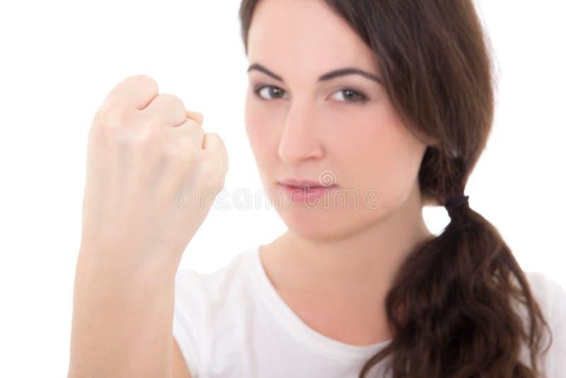 Mulher que mostra o punho da raiva isolado no fundo branco imagem de stock