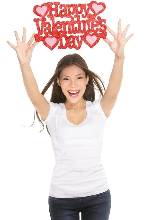 Mulher que mostra o sinal do dia de Valentim imagem de stock