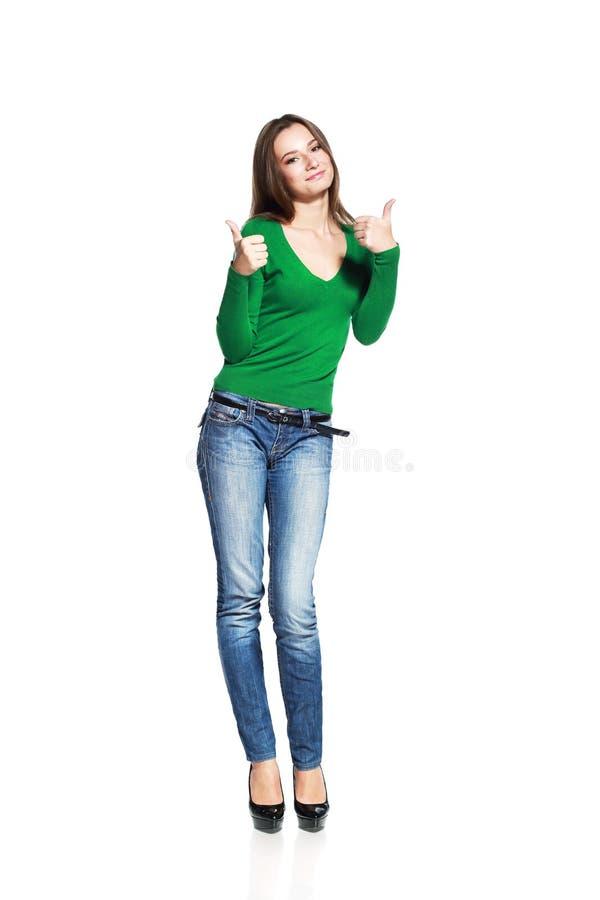 Mulher que mostra os polegares fotografia de stock royalty free