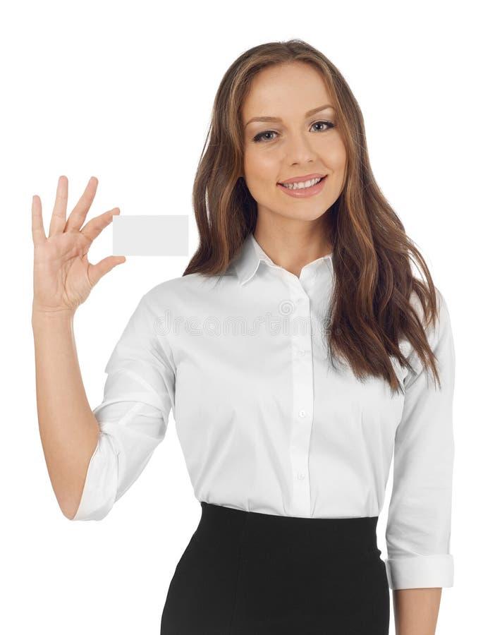 Mulher que mostra um cartão foto de stock royalty free