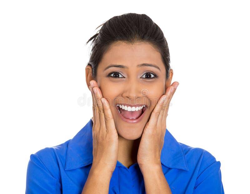 Mulher que olha chocada surpreendido, mãos em mordentes fotografia de stock royalty free