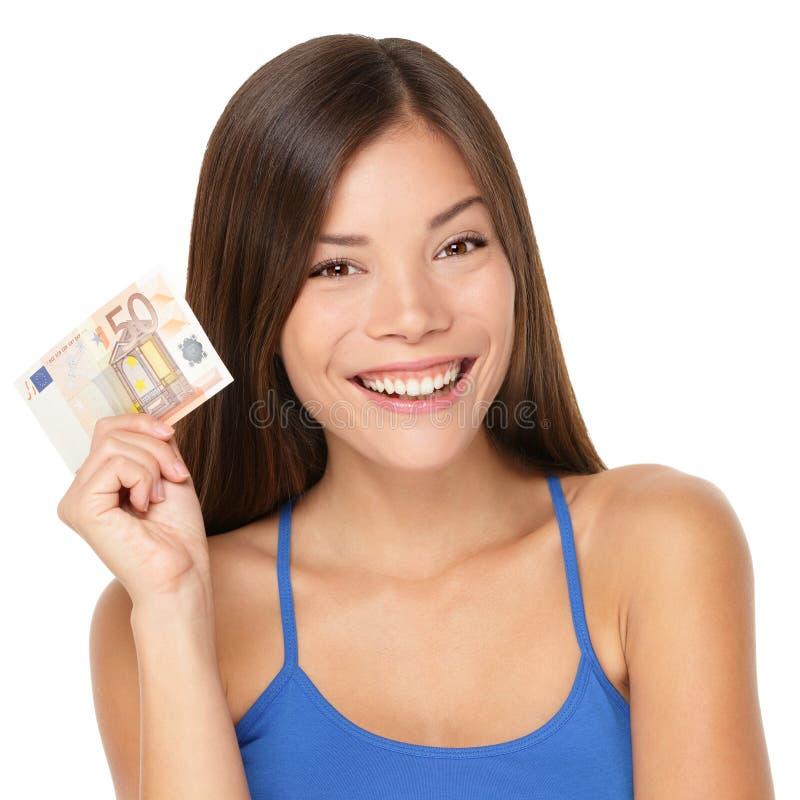 Mulher que prende a euro- nota do dinheiro fotografia de stock royalty free