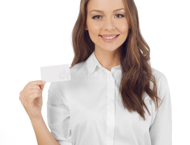 Mulher que prende um cartão fotos de stock royalty free