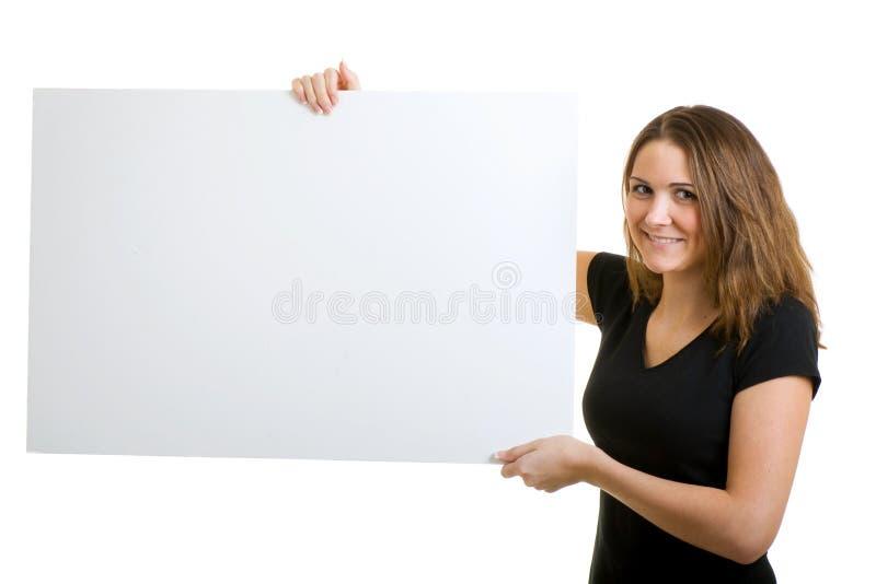 Mulher que prende um sinal. fotos de stock
