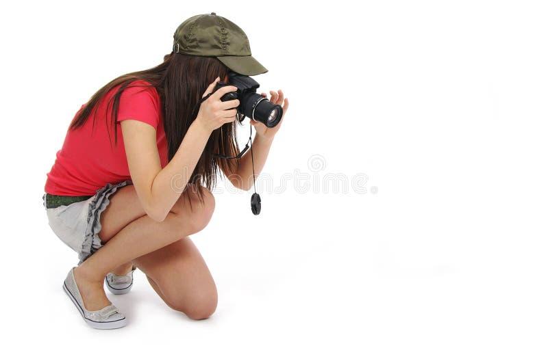 Mulher que prende uma câmera da foto imagens de stock