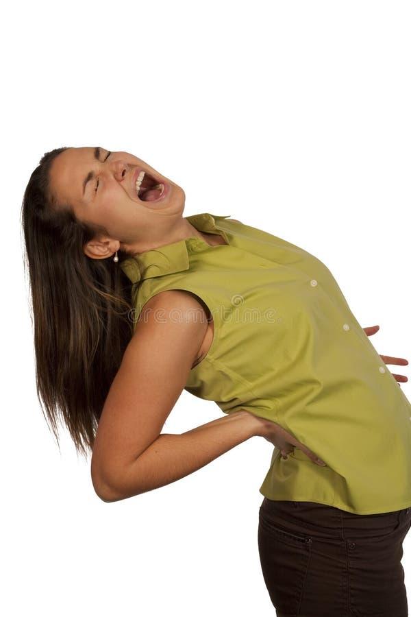 Mulher que sofre da dor traseira foto de stock royalty free