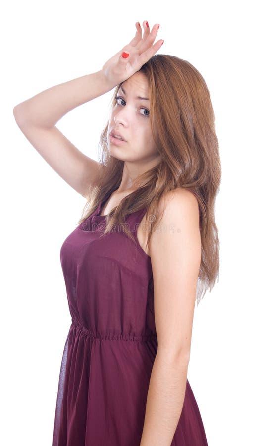 Mulher que tem uma dor de cabeça fotografia de stock