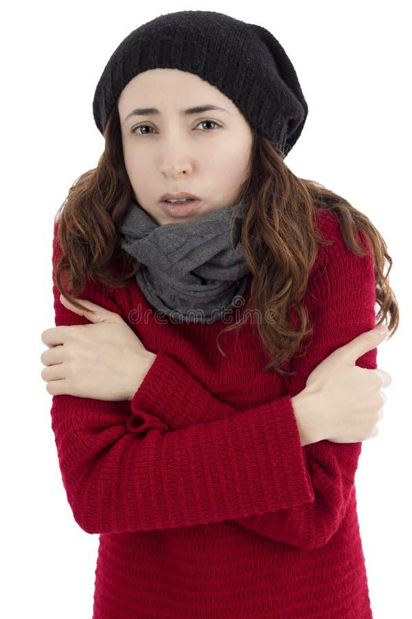 Mulher que tirita devido ao frio imagens de stock royalty free