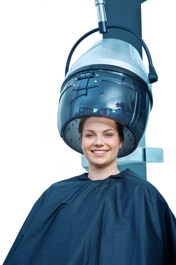 Mulher que usa o secador de cabelo fotos de stock