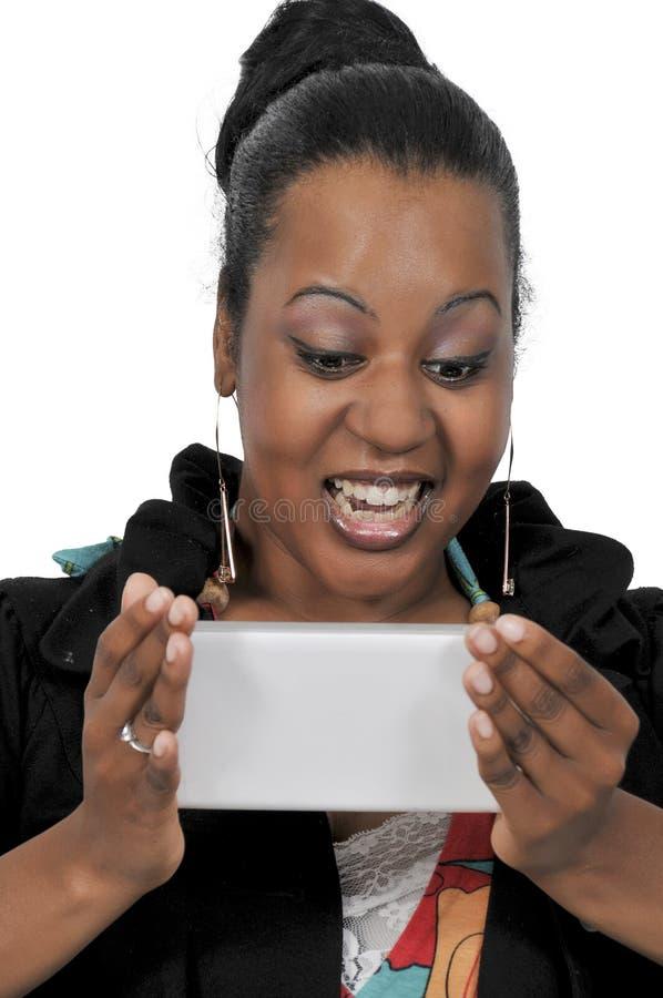 Mulher que usa a tabuleta fotos de stock