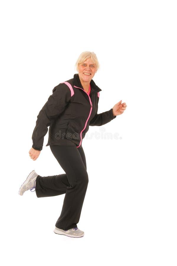 Mulher running da idade madura fotos de stock