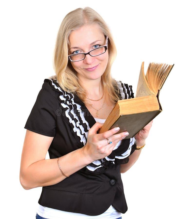 Mulher séria nova com livro imagens de stock