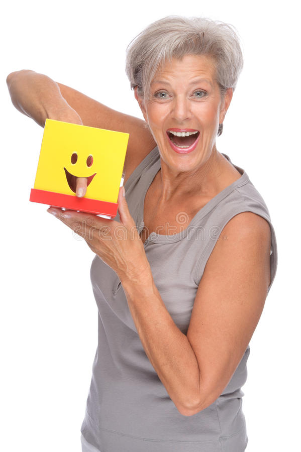 Mulher sênior com caixa imagem de stock