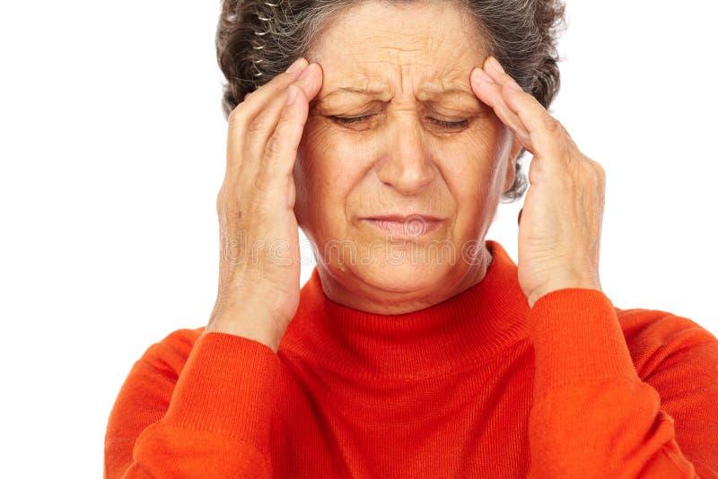 Mulher sênior com dor de cabeça fotografia de stock royalty free