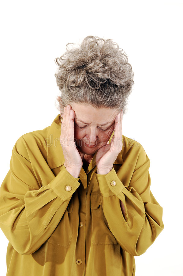 Mulher sênior com uma dor de cabeça. foto de stock royalty free