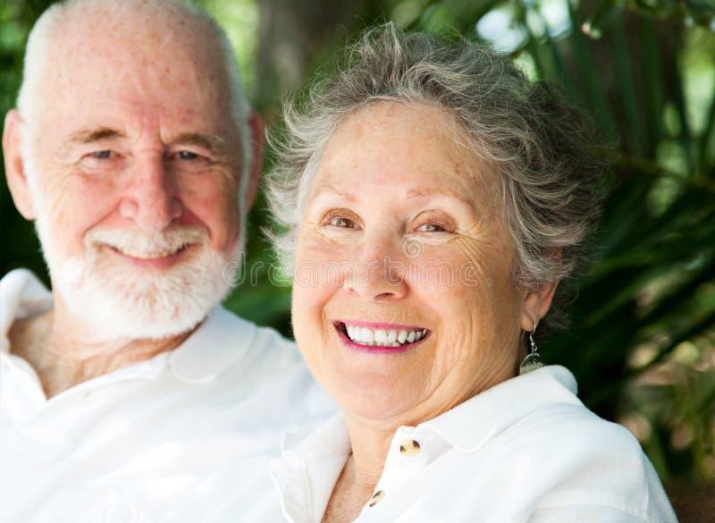 Mulher sênior feliz com marido imagens de stock