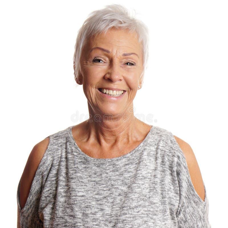 Mulher sênior feliz com sorriso toothy fotografia de stock royalty free