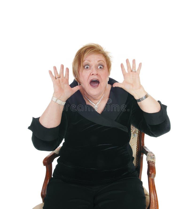 Mulher sênior gritando imagem de stock royalty free