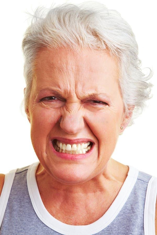 Mulher sênior irritada fotografia de stock royalty free