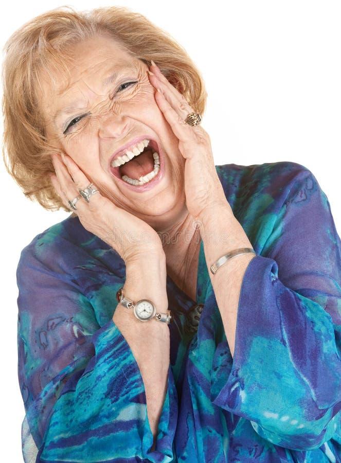 Mulher sênior loura que grita fotografia de stock royalty free
