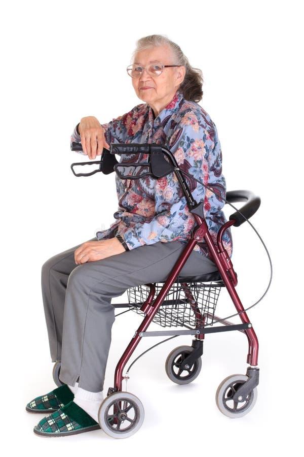 Mulher sênior na cadeira de rodas imagens de stock royalty free