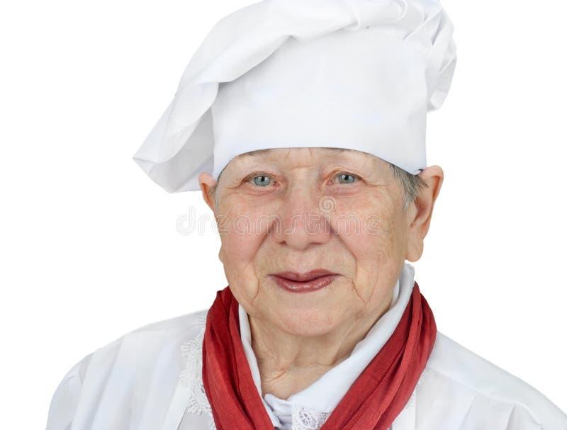 Mulher sênior no chapéu do cozinheiro chefe fotos de stock royalty free