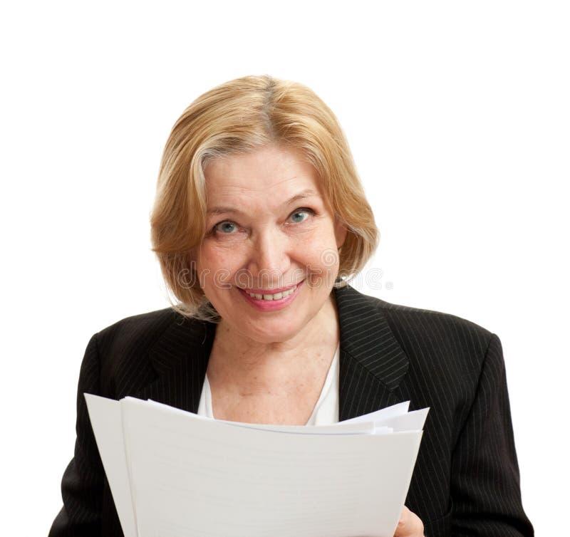 Mulher sênior no preto no fundo branco fotografia de stock