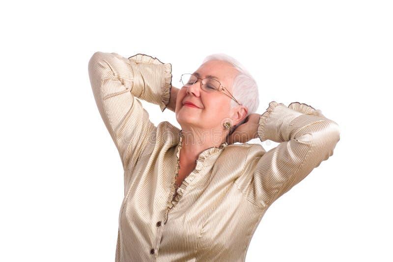 Mulher sênior que estica com alegria imagem de stock royalty free