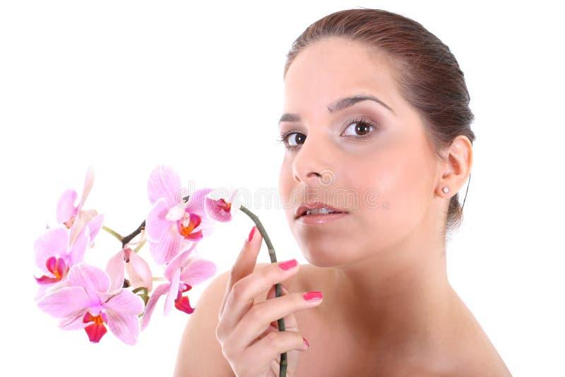 Mulher saudável bonita nova com orquídea foto de stock royalty free