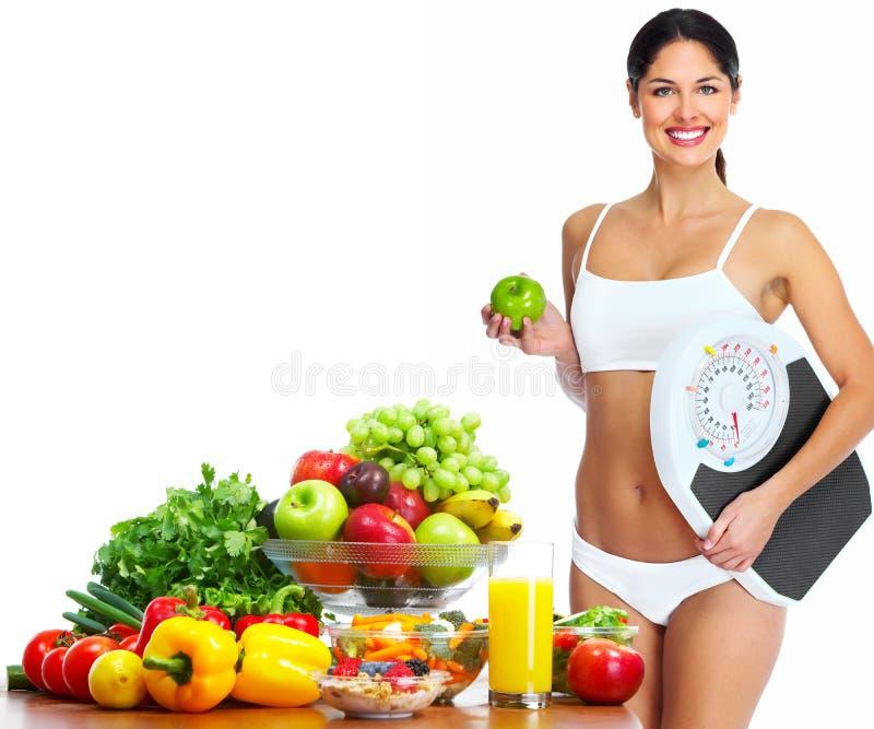 Mulher saudável nova com frutos. fotografia de stock