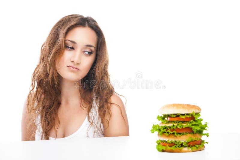 Mulher saudável que rejeita a comida lixo isolada fotografia de stock