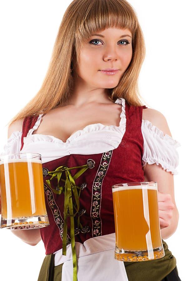 Mulher sedutor Oktoberfest com cerveja imagens de stock royalty free