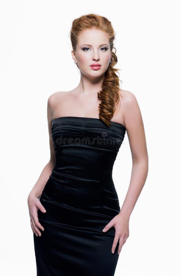 Mulher sensual bonita no vestido preto imagens de stock royalty free