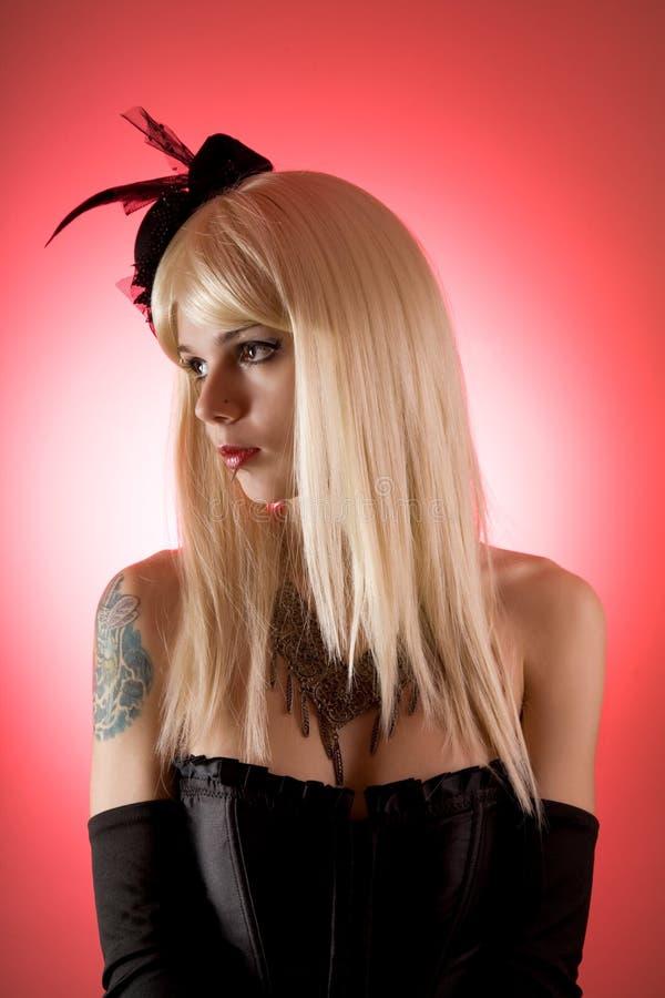 Mulher sensual no espartilho preto fotografia de stock