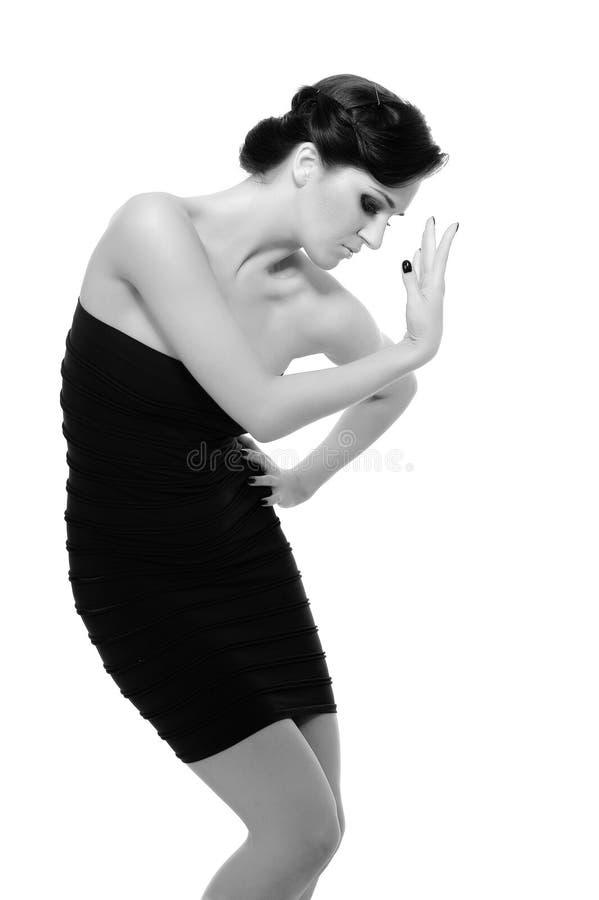 Mulher 'sexy' bonita no vestido elegante curto fotografia de stock royalty free
