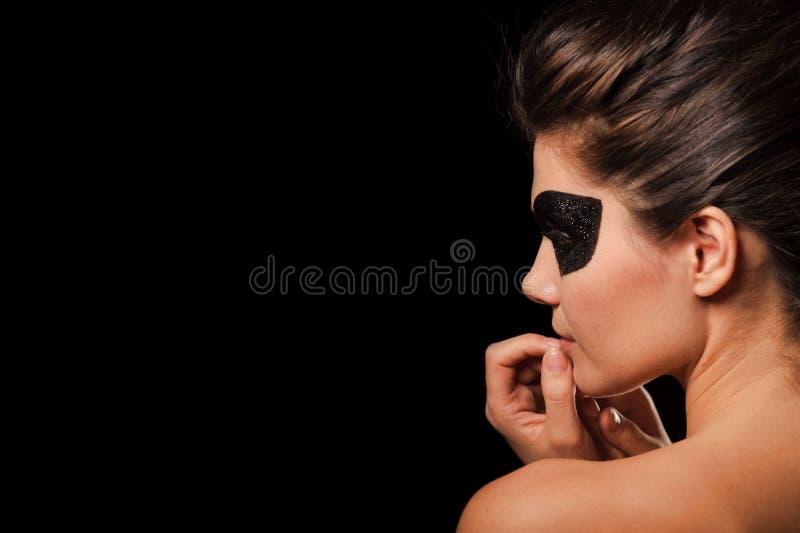 Mulher 'sexy' com máscara preta do partido imagens de stock