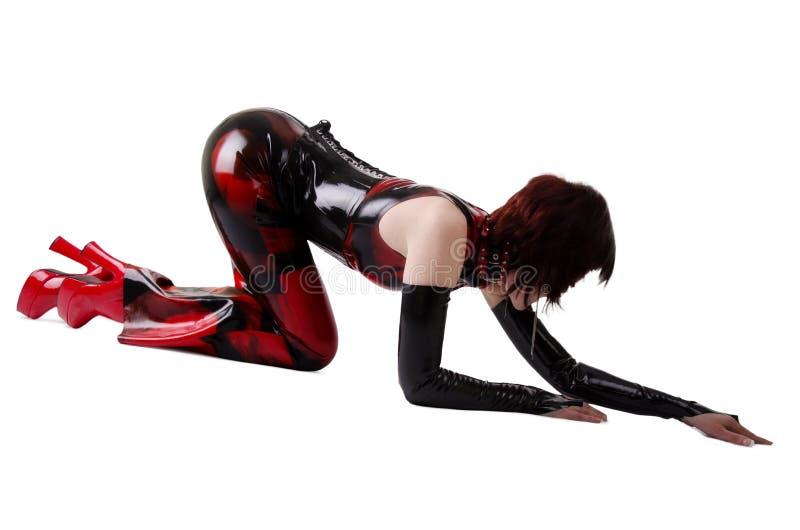 Mulher 'sexy' no vestido do látex imagem de stock royalty free