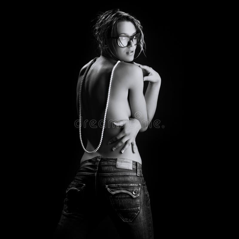 Mulher 'sexy' nova nas calças de brim imagem de stock royalty free