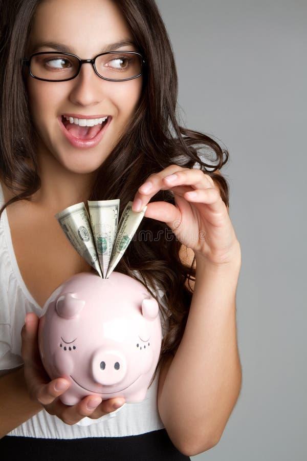 Mulher Sneaky do dinheiro fotografia de stock royalty free