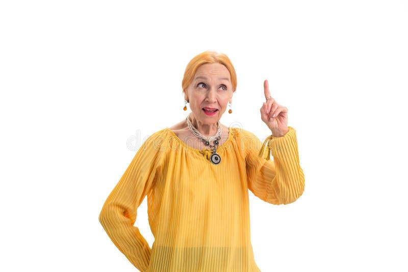 Mulher superior com dedo aumentado imagem de stock