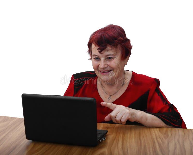 Mulher superior de sorriso com portátil fotografia de stock royalty free