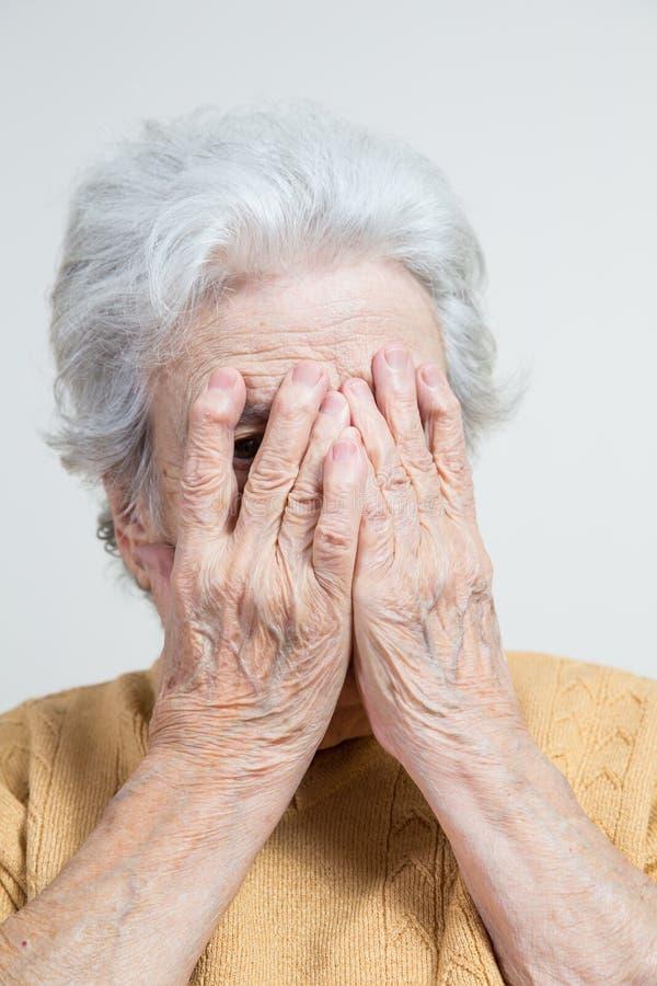Mulher superior que esconde sua cara imagens de stock royalty free