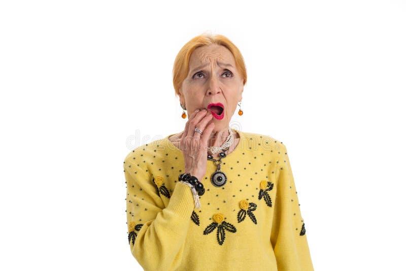 Mulher superior que tem a dor de dente imagens de stock royalty free