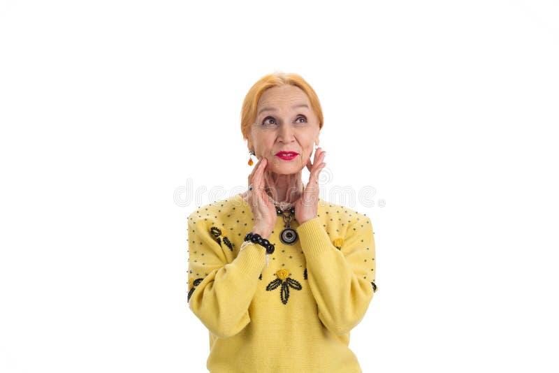 Mulher superior que toca em sua cara foto de stock royalty free