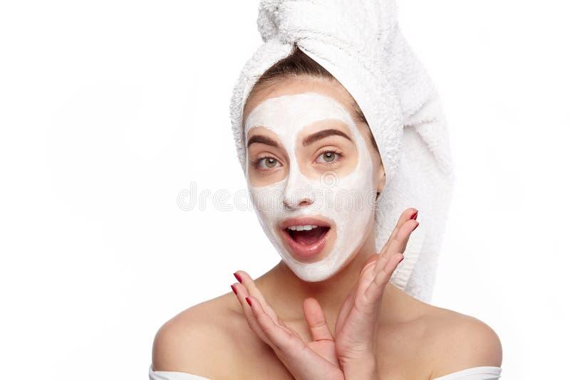 Mulher surpreendida com máscara dos cosméticos fotos de stock royalty free