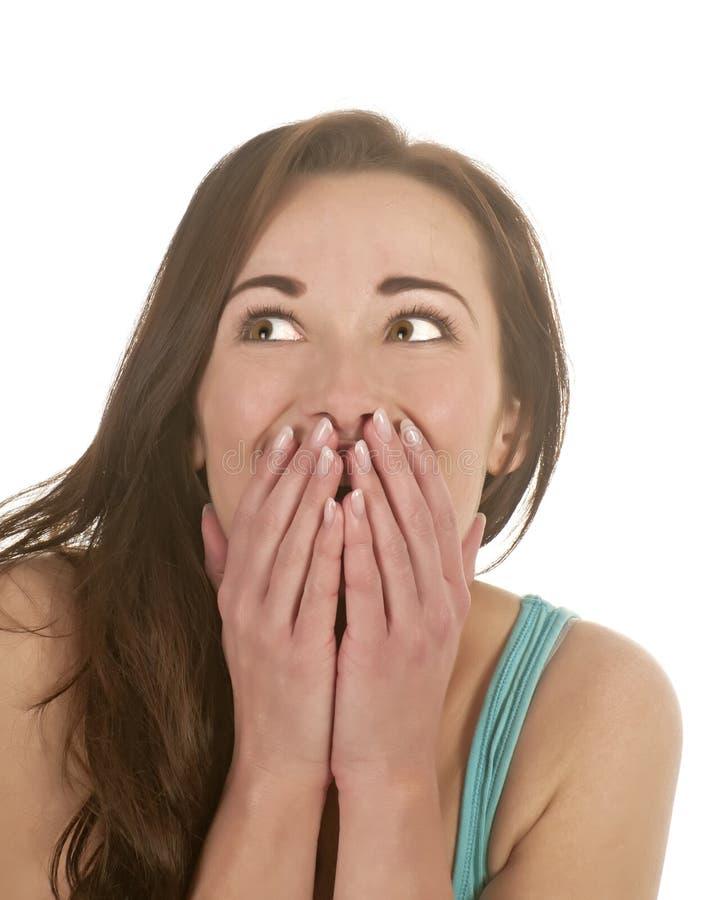 Mulher surpreendida que olha acima foto de stock