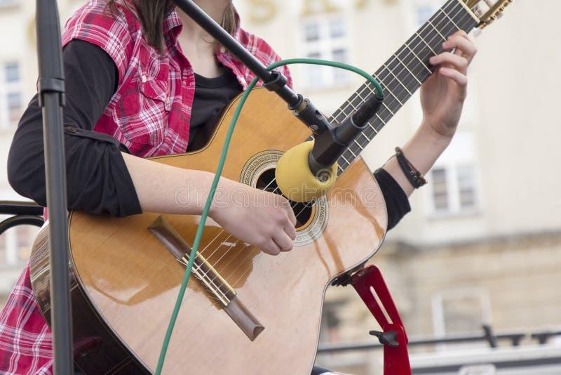 Mulher três da guitarra foto de stock