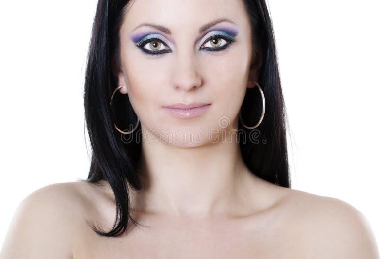 Mulher triguenha com composição azul e roxa foto de stock
