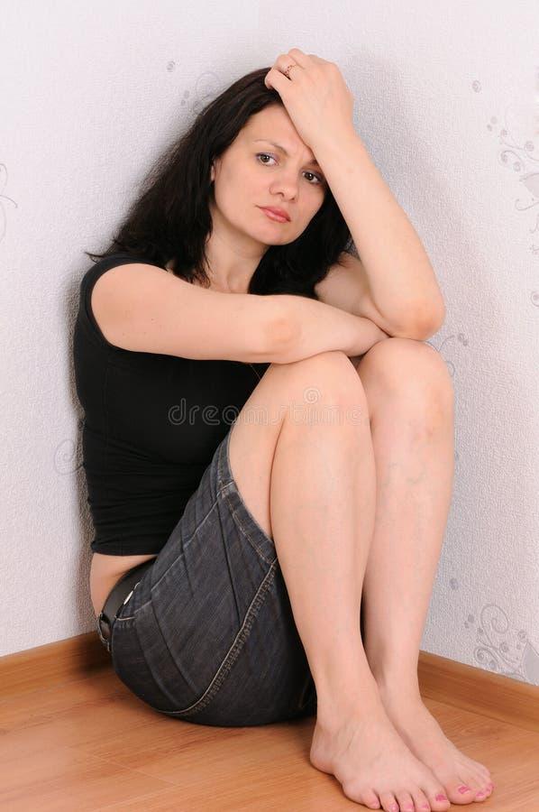 A mulher triste imagem de stock