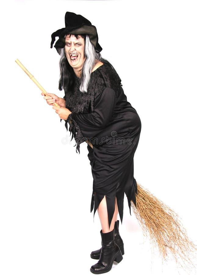 Mulher vestida como uma bruxa feia fotografia de stock royalty free